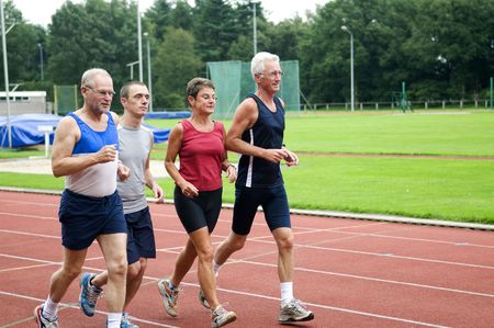 race track: Group of running people on a race track