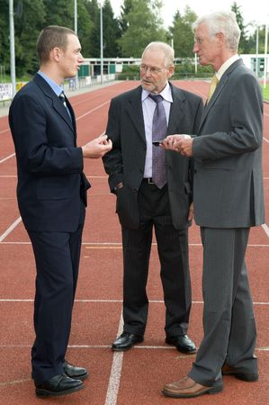 Businessmen discussing their business on a race track. photo