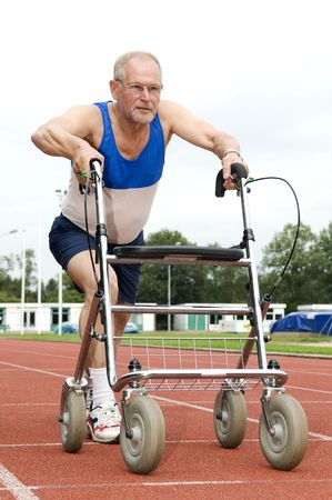 This active senior wont stop sporting, even now that he is using a walker! Caricature of health, sports, disability, ability, getting older, feeling young. Stock Photo