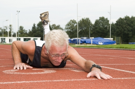 Active senior finally made it to the finish line. Stock Photo - 3520630
