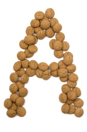 ginger nuts: Little ginger nuts in the form of the letter A. These little ginger nuts are used in Holland for the Sinterklaas party, which is at Dec 5 every year. Sinterklaas is a sort of Santa Claus. In Holland these ginger nuts are called pepernoot. Isolated on