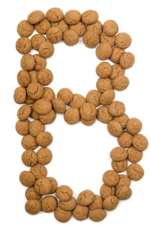 pepernoot: Little ginger nuts in the form of the letter B. These little ginger nuts are used in Holland for the Sinterklaas party, which is at Dec 5 every year. Sinterklaas is a sort of Santa Claus. In Holland these ginger nuts are called pepernoot. Isolated on