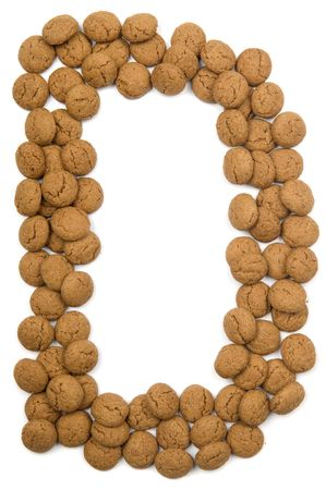 pepernoot: Little ginger nuts in the form of the letter D. These little ginger nuts are used in Holland for the Sinterklaas party, which is at Dec 5 every year. Sinterklaas is a sort of Santa Claus. In Holland these ginger nuts are called pepernoot. Isolated on