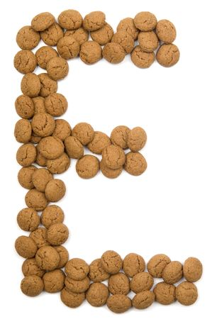 pepernoot: Little ginger nuts in the form of the letter E. These little ginger nuts are used in Holland for the Sinterklaas party, which is at Dec 5 every year. Sinterklaas is a sort of Santa Claus. In Holland these ginger nuts are called pepernoot. Isolated on  Stock Photo