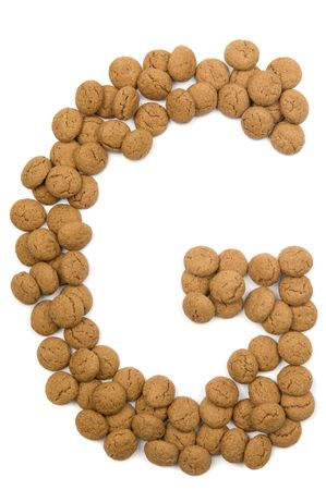 pepernoot: Little ginger nuts in the form of the letter G. These little ginger nuts are used in Holland for the Sinterklaas party, which is at Dec 5 every year. Sinterklaas is a sort of Santa Claus. In Holland these ginger nuts are called pepernoot. Isolated on