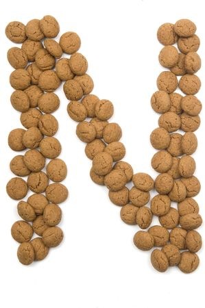sinterklaas: Little ginger nuts in the form of the letter N. These little ginger nuts are used in Holland for the Sinterklaas party, which is at Dec 5 every year. Sinterklaas is a sort of Santa Claus. In Holland these ginger nuts are called pepernoot. Isolated on