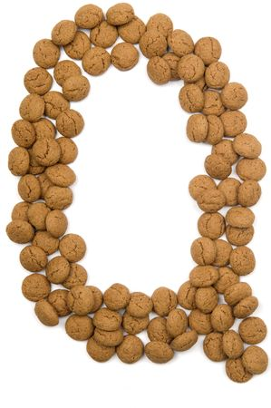 pepernoot: Little ginger nuts in the form of the letter Q. These little ginger nuts are used in Holland for the Sinterklaas party, which is at Dec 5 every year. Sinterklaas is a sort of Santa Claus. In Holland these ginger nuts are called pepernoot. Isolated on  Stock Photo