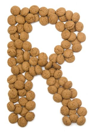 pepernoot: Little ginger nuts in the form of the letter R. These little ginger nuts are used in Holland for the Sinterklaas party, which is at Dec 5 every year. Sinterklaas is a sort of Santa Claus. In Holland these ginger nuts are called pepernoot. Isolated on