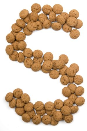 Little ginger nuts in the form of the letter S. These little ginger nuts are used in Holland for the Sinterklaas party, which is at Dec 5 every year. Sinterklaas is a sort of Santa Claus. In Holland these ginger nuts are called pepernoot. Isolated on  photo