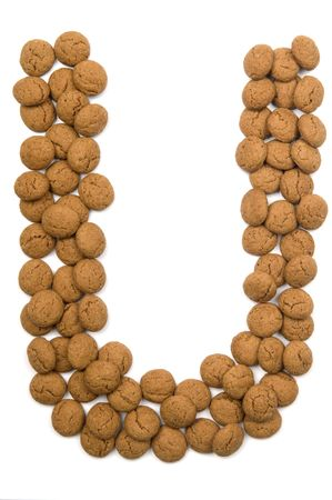 pepernoot: Little ginger nuts in the form of the letter U. These little ginger nuts are used in Holland for the Sinterklaas party, which is at Dec 5 every year. Sinterklaas is a sort of Santa Claus. In Holland these ginger nuts are called pepernoot. Isolated on