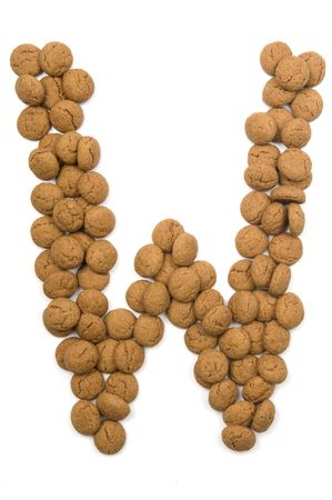 pepernoot: Little ginger nuts in the form of the letter W. These little ginger nuts are used in Holland for the Sinterklaas party, which is at Dec 5 every year. Sinterklaas is a sort of Santa Claus. In Holland these ginger nuts are called pepernoot. Isolated on  Stock Photo