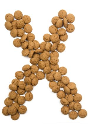 pepernoot: Little ginger nuts in the form of the letter X. These little ginger nuts are used in Holland for the Sinterklaas party, which is at Dec 5 every year. Sinterklaas is a sort of Santa Claus. In Holland these ginger nuts are called pepernoot. Isolated on