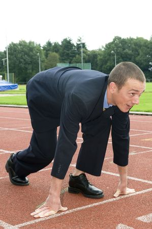Businessman is ready for the start of his run. Stock Photo - 3570893