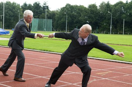Two businessmen working as a team during a run. photo
