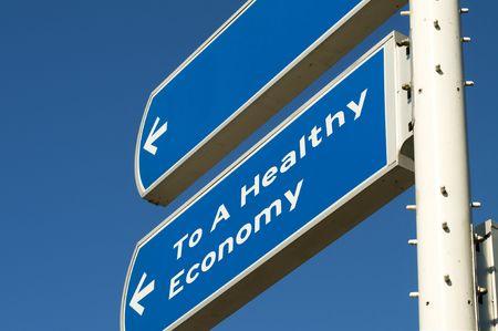 would: Roadsign che vi mostra la strada per una sana economia. Desiderio sarebbe che facile! Archivio Fotografico