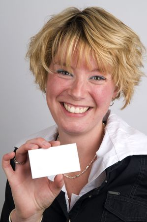Young attractive business woman holding a white card photo