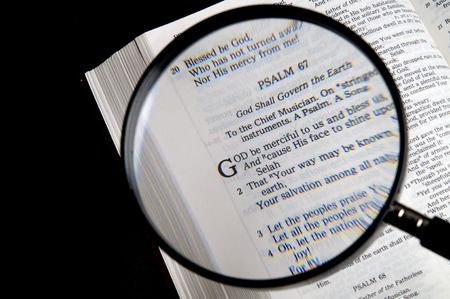 Loupe on a Bible. If  youre searching for answers, read it! photo