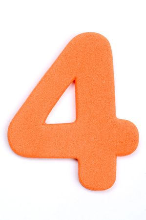 The digit four in foam material. Stock Photo