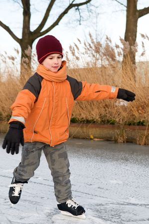 Boy ice skating for the first time