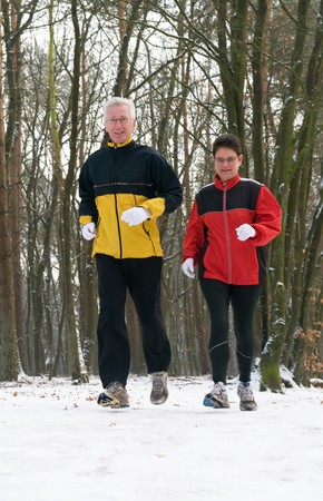 Running seniors in wintertime Stock Photo