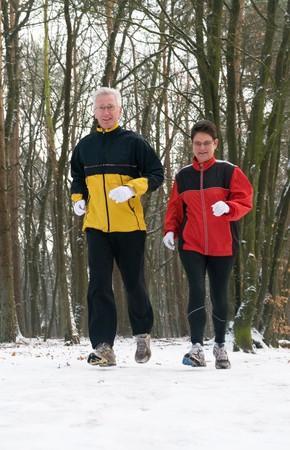 Running seniors in wintertime Stock Photo
