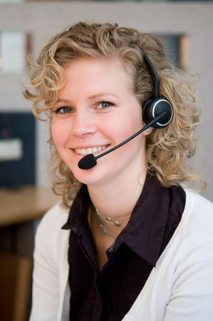Receptionist or frontdesk worker in an office. photo