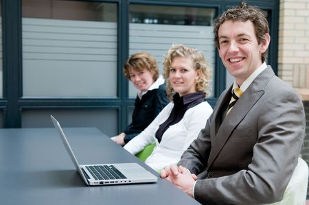 Business people in an office, during a meeting. Stock Photo - 4813724