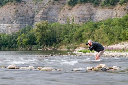 Photographer risking his camera in the stream of the Ardeche, France Stock Photo - 5342912
