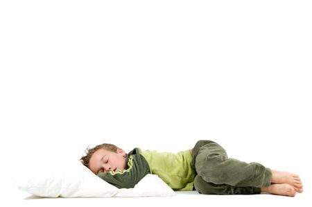 Eight year old boy sleeping and dreaming, isolated on white.