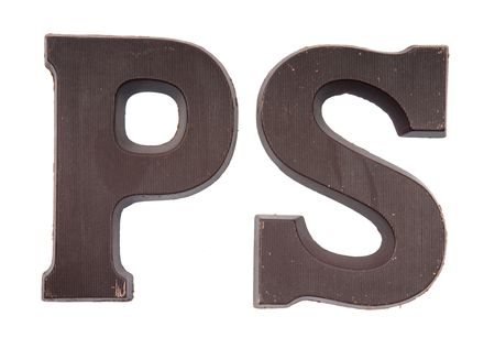 Chocolate letter in the form of a P and an S. Used very often in country's where they celebrate Sinterklaas. Kids get the first letter of their name. S also stands for Sinterklaas, and P for Piet (Zwarte Piet). Stock Photo - 5709214