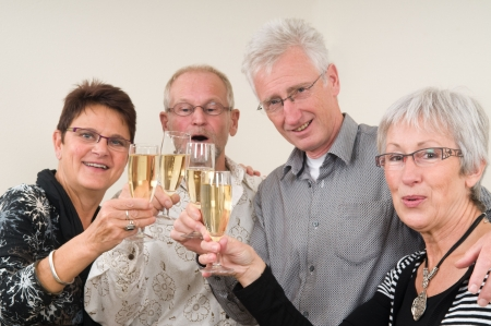 senior couples: Two senior couples toasting on a Happy New Year.