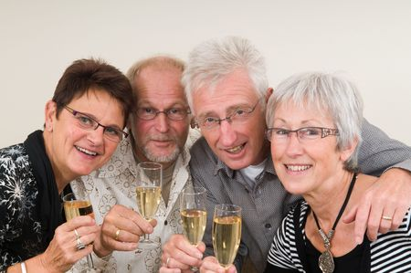 Two senior couples toasting on a Happy New Year.