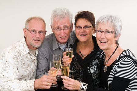 Two senior couples toasting on a Happy New Year. Фото со стока - 5835729