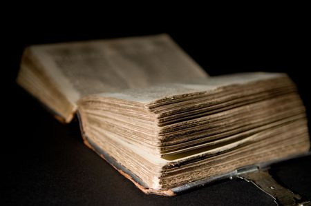 Nice old bible with an old lock on a black background. Stock Photo - 5986093