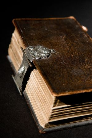 Nice old bible with an old lock on a black background. Stock Photo - 5986094