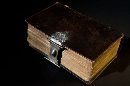 Nice old bible with an old lock on a black background. Stock Photo - 5980432