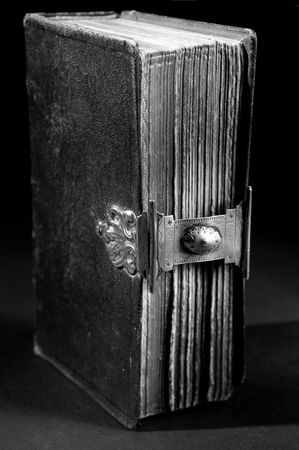 Nice old bible with an old lock on a black background. In black & white. Stock Photo - 5980431