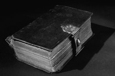 Nice old bible with an old lock on a black background. In black & white. Stock Photo - 5980430