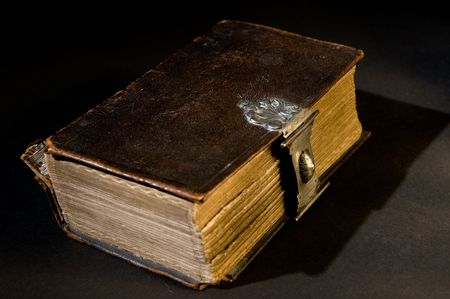 Nice old bible with an old lock on a black background. Stock Photo - 5980426
