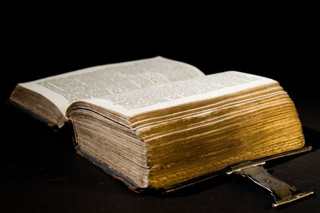 Nice old bible with an old lock on a black background. Stock Photo - 5980429