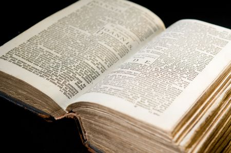 Nice old bible with an old lock on a black background. Stock Photo - 5980423