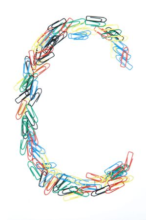 monotype: Letter C formed with colorful paperclips Stock Photo