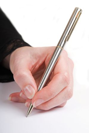 Simple isolated image of a hand writing with a pen. photo
