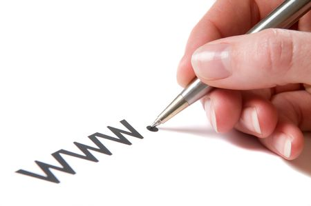 url: Hand with pen writing an url, starting with www