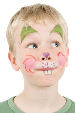 teen boy face: Child with his face painted as a rabbit. Stock Photo