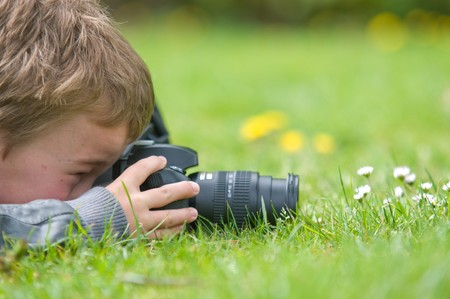nine years old: Young boy, nine years old, already practicing with an SLR shooting pictures of nature.