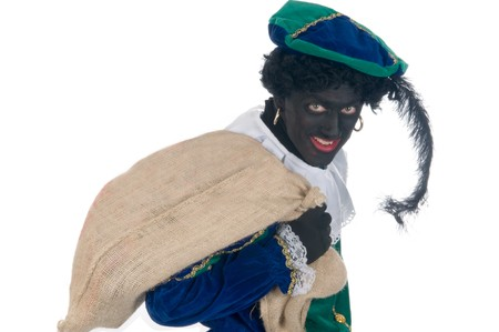 zak: Zwarte Piet is carrying a bag full of presents for the children. It is called de zak van Sinterklaas. Sinterklaas is a Dutch tradition which is celebrated on Dec. 5th.