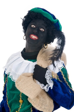 Zwarte Piet is carrying a bag full of presents for the children. It is called de zak van Sinterklaas. Sinterklaas is a Dutch tradition which is celebrated on Dec. 5th. photo