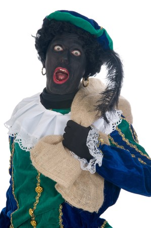 zak: Zwarte Piet is carrying a bag full of presents for the children. It is called de zak van Sinterklaas. Sinterklaas is a Dutch tradition which is celebrated on Dec. 5th.