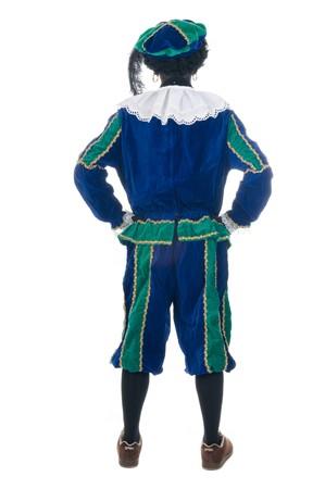 zwarte: Zwarte Piet is looking away. Zwarte Piet is a Dutch tradition during Sinterklaas, which is celebrated in December the fifth. Stock Photo